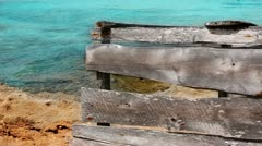 Aged grunge gray wood on turquoise beach of Formentera island Stock Footage