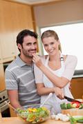 Stock Photo of Portrait of a charming couple cooking
