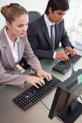 Portrait of business people working with computers - stock photo