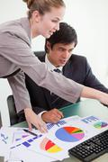Portrait of a professional business team studying statistics - stock photo
