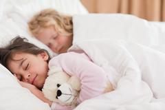 Quiet siblings sleeping - stock photo