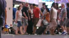 Crowd of people walking crossing street at night in New York City 60P Stock Footage