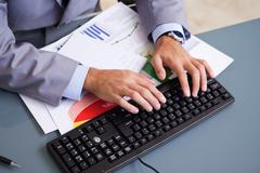 Stock Photo of Hands typing on keyboard