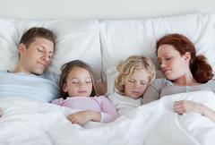 Stock Photo of Family taking a nap together