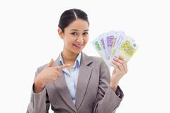 Stock Photo of Smiling businesswoman holding bank notes