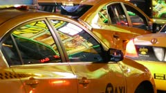 Yellow Cab window glass glare at night in New York City 30P Stock Footage