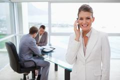 Smiling marketing manager on the phone - stock photo