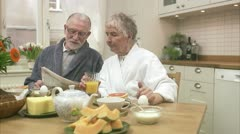 An elderly couple having breakfast Stock Footage