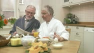 Stock Video Footage of An elderly couple having breakfast