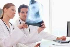 Stock Photo of Doctor showing her colleague an x-ray