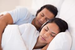 Stock Photo of Side view of couple being asleep