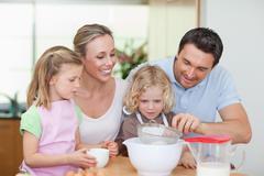 Stock Photo of Family preparing dough