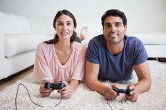 Young couple playing video games - stock photo