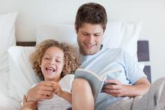Father reading bedtime story for child - stock photo