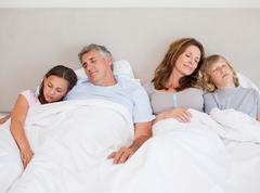 Family napping together - stock photo