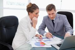 Stock Photo of Business team analyzing market research