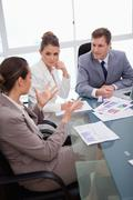 Business team talking about survey - stock photo