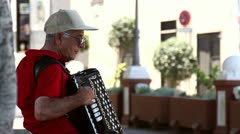 Older man playing on a accordion Stock Footage