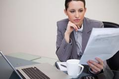Stock Photo of Businesswoman reading contract