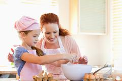 Mother and daughter preparing cookies - stock photo