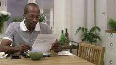 A man doing paper work at home - stock footage