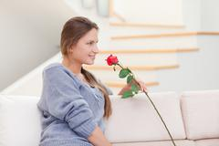 Woman posing with a rose - stock photo