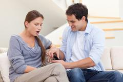 Man proposing marriage to his girlfriend - stock photo