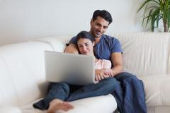 Stock Photo of Couple watching a movie while eating popcorn