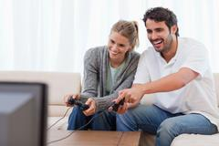Stock Photo of Couple playing video games