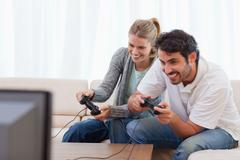 Stock Photo of Cheerful couple playing video games