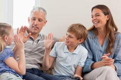 Cheerful family playing video games - stock photo