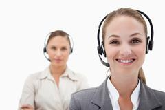 Smiling operators with headsets - stock photo