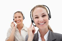 Happy operators using headsets - stock photo