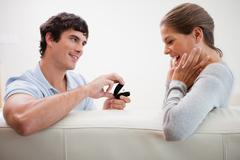 Man making a proposal of marriage - stock photo
