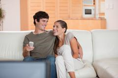 Stock Photo of Laughing couple watching funny movie together