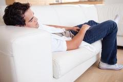 Male taking a nap on the sofa Stock Photos