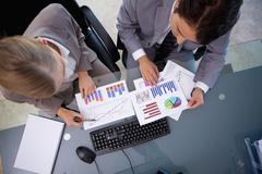 Business team looking at statistics - stock photo