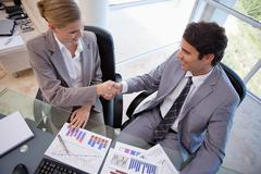 Business people agreeing on a deal - stock photo