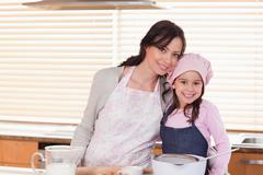 Stock Photo of Mother and daughter baking