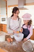Stock Photo of Portrait of a happy mother and her daughter baking