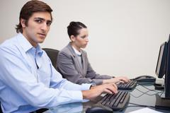 Side view of business people working next to each other - stock photo