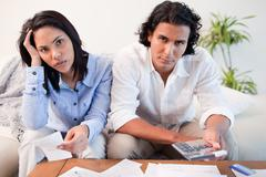 Couple calculating their costs Stock Photos