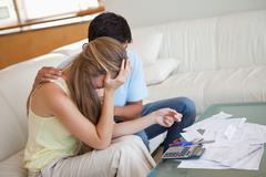 Sad couple in financial trouble - stock photo