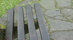 Rain park bench cloue up ciggerette Stock Footage