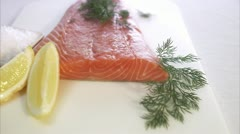 Raw spiced salmon being prepared Stock Footage