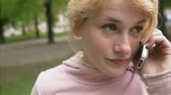 CU Teenage girl talking on mobile phone / Stockholm Stock Footage