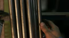 The hand of worker takes a metallic pipe at the plant Stock Footage