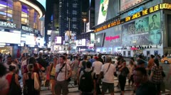 Crowd of people walking in Times Square New York City at night time lapse Stock Footage