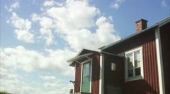 WS T/L View of moving clouds over cottage / Stockholm Stock Footage