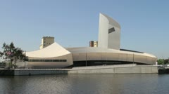 Imperial War Museum North in Salford Quays, Manchester on a sunny day Stock Footage